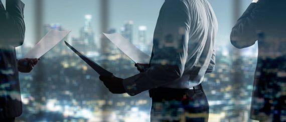 1134635444-businessman-with-documents-4Y0k-4Y0k-2048x1152-MM-78
